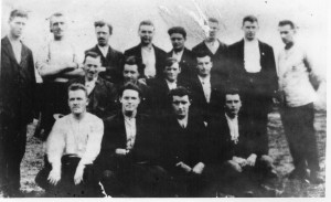 Patrick Tunney is the middle row, second from the left and his brother Michael Tunney is the back row, fifth from the left. It is believed this is a photograph of Mayo prisoners in the Curragh internment camp.